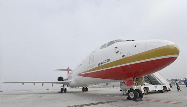 国产大飞机载客首航成功 将开7条航线
